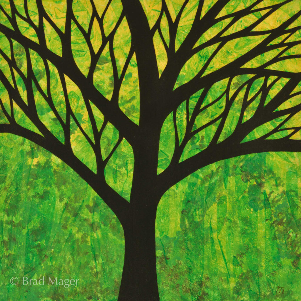 Silhouette of tree with sinuous branches against a green woodland background