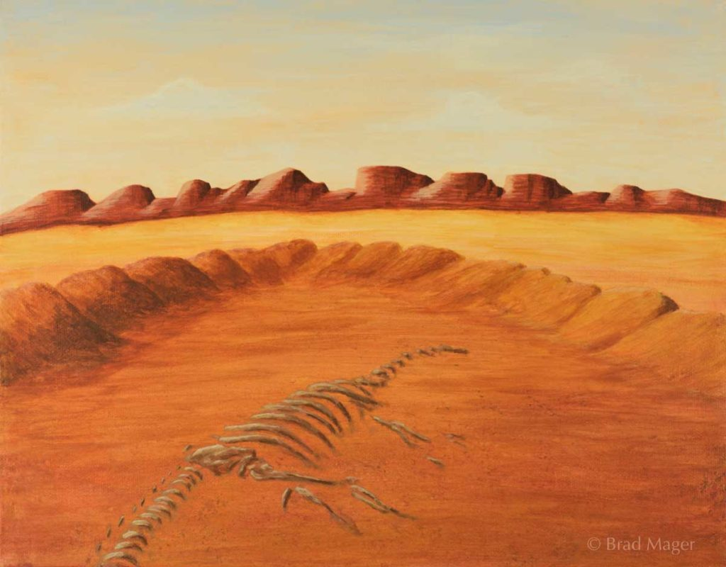 Dinosaur bones slightly uncovered in the middle of a lonely desert landscape