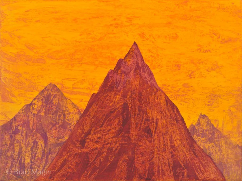 Red and purple rocky peaks against a swirling yellow sky