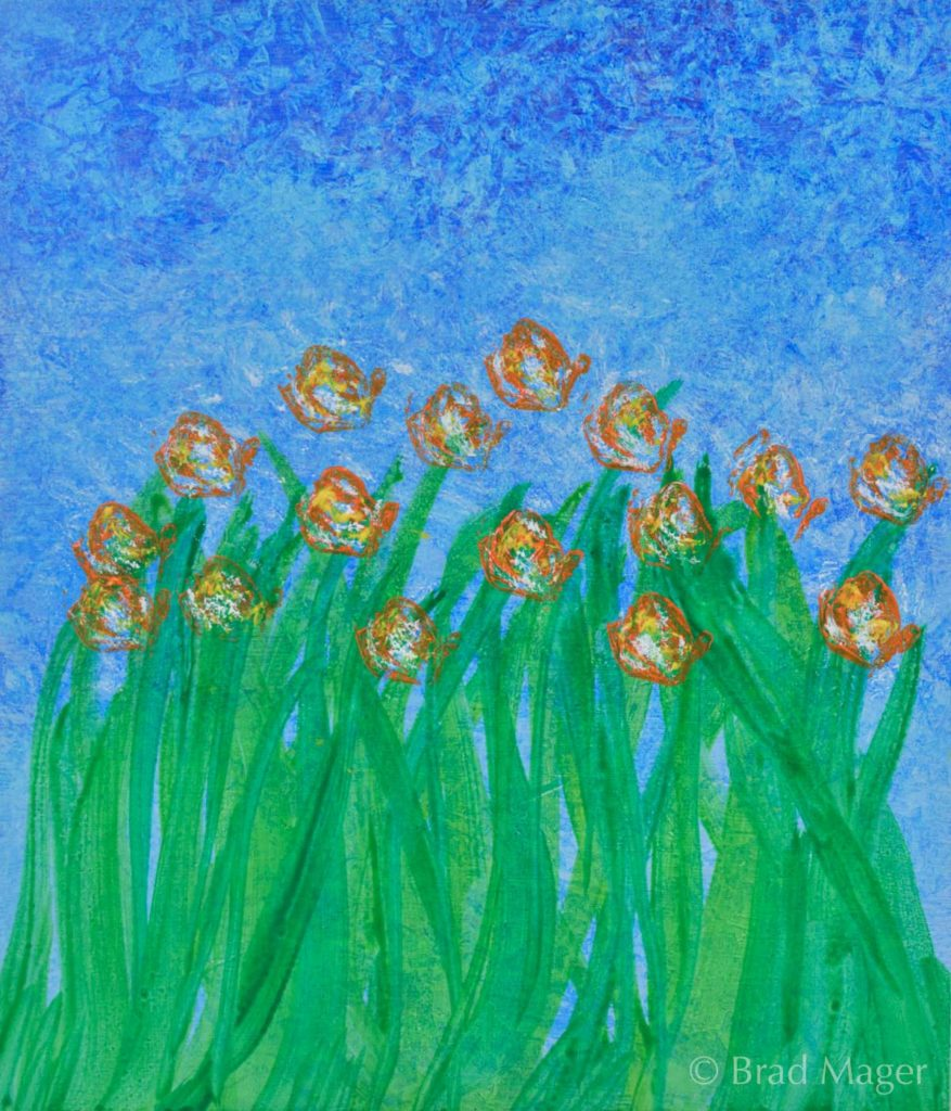 A patch of bright wildflowers with orange and yellow petals swaying atop green stems